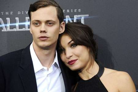 Alida is not married to Bill and he they are at a red carpet event.