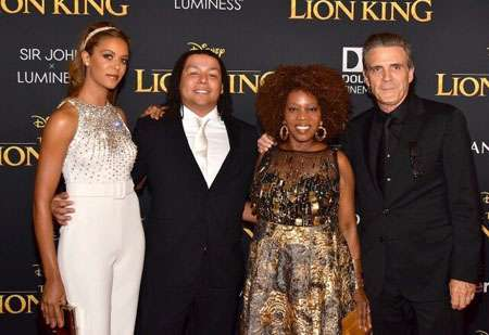 Alfre Woodard with her family, husband and two children during the red carpet event of The Lion King.