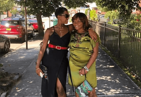 Lashana with her mom in the street.