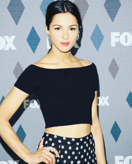 Annet Mahendru taking a picture in front of the FOX board.