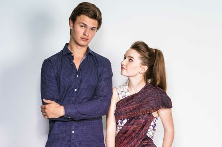 Ansel Elgort and Kaitlyn Dever taking a picture together.