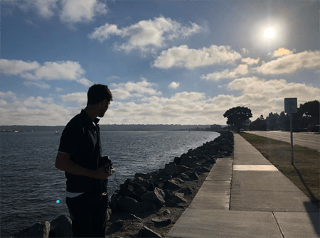 Anya Chalotra taking the photo of her brother near the ocean, after being on a break from playing Yennefer.