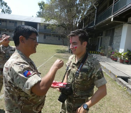 benjamin getting tika on his forehead after becoming a Gurkha officer.