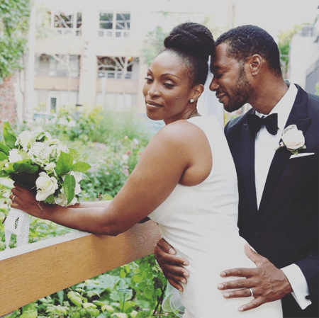 Lisa Berry and her husband Dion Johnstone during their marriage ceremony.