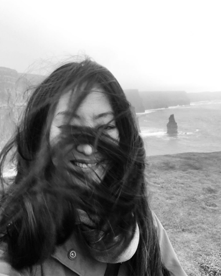 Elizabeth Anweis with her hair covering her face due to the wind.