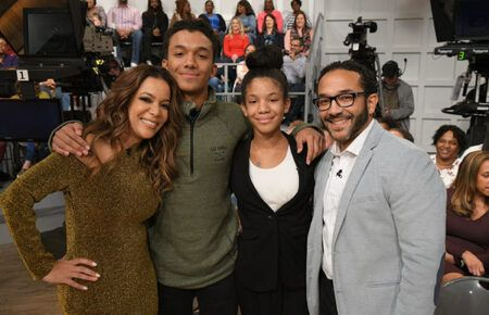 Sunny Hostin and Emmanuel Hostin with their kids in an adorable family picture.