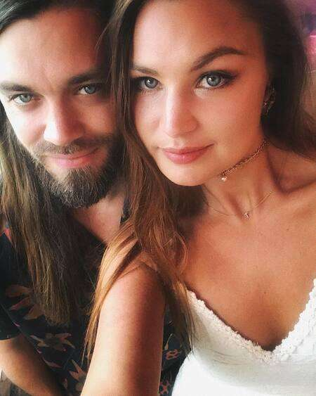 Walking Dead actor Tom Payne is engaged to his girlfriend turned fiancee Jennifer Akerman.