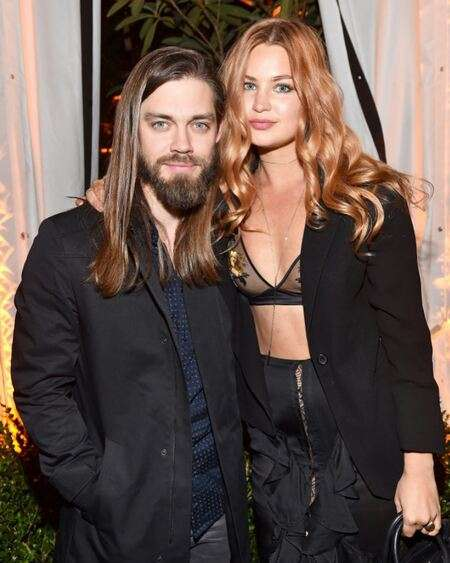 Walking Dead actor Tom Payne is dating girlfriend turned fiancee Jennifer Akerman; the couple is in a relationship since 2013.