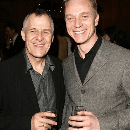 Ian Gelder and Ben Daniels are sharing a drink.