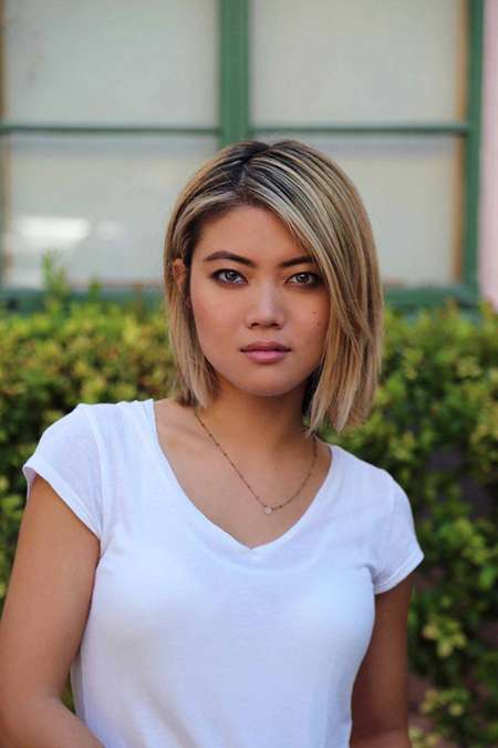 Jessica Lu with a short trimmed hair and white t-shirt.