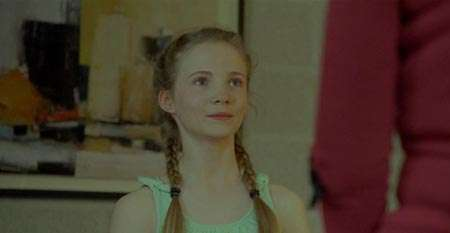 Freya Allan in one of her movies scene with braids.