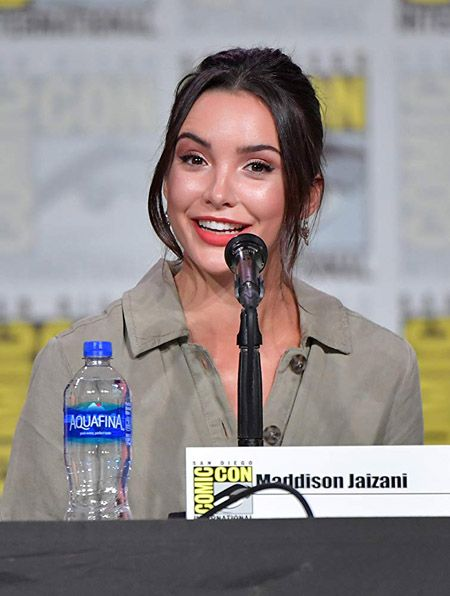 Maddison Zaizani at the comic con, talking about Bess Marvin in the show Nancy Drew.