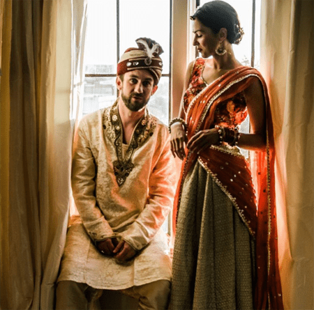 Annet Mahendru and her husband in Indian wedding dress.