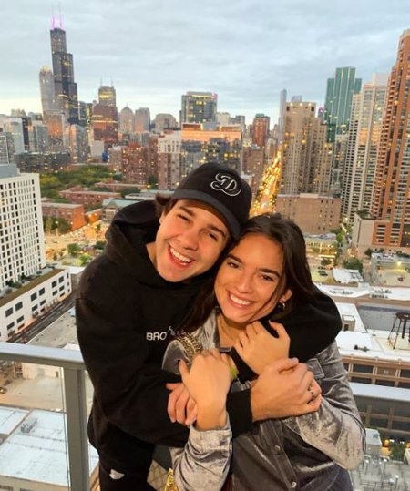David Dobrik and Natalie Noel are childhood friends but fans are reading between the lines when it comes to their relationship.