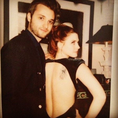 Alexandra Breckenridge back tattoo is something of a north symbol.