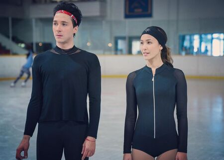"Kaitlyn Leeb and Johnny Weir as Leah Starnes and Gabriel ""Gabe"" Richardson, respectively, in the Netflix ice skating series Spinning Out (2020)."