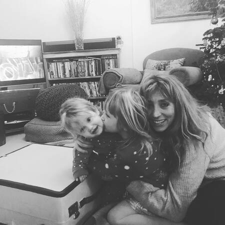 Daisy Haggard with her two daughters.